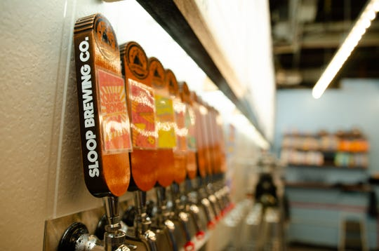 Beer taps at Sloop Brewing Company at The Factory in East Fishkill.