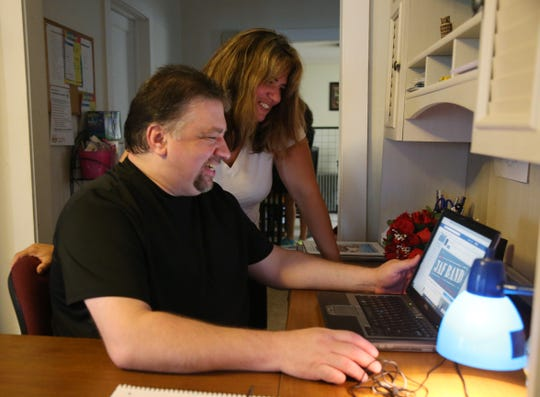 Amanda Schott-Just and Edward Just look over facebook at their home in the Village of Wappingers Falls on September 11, 2018. The couple met on Facebook and were married in August 2018.