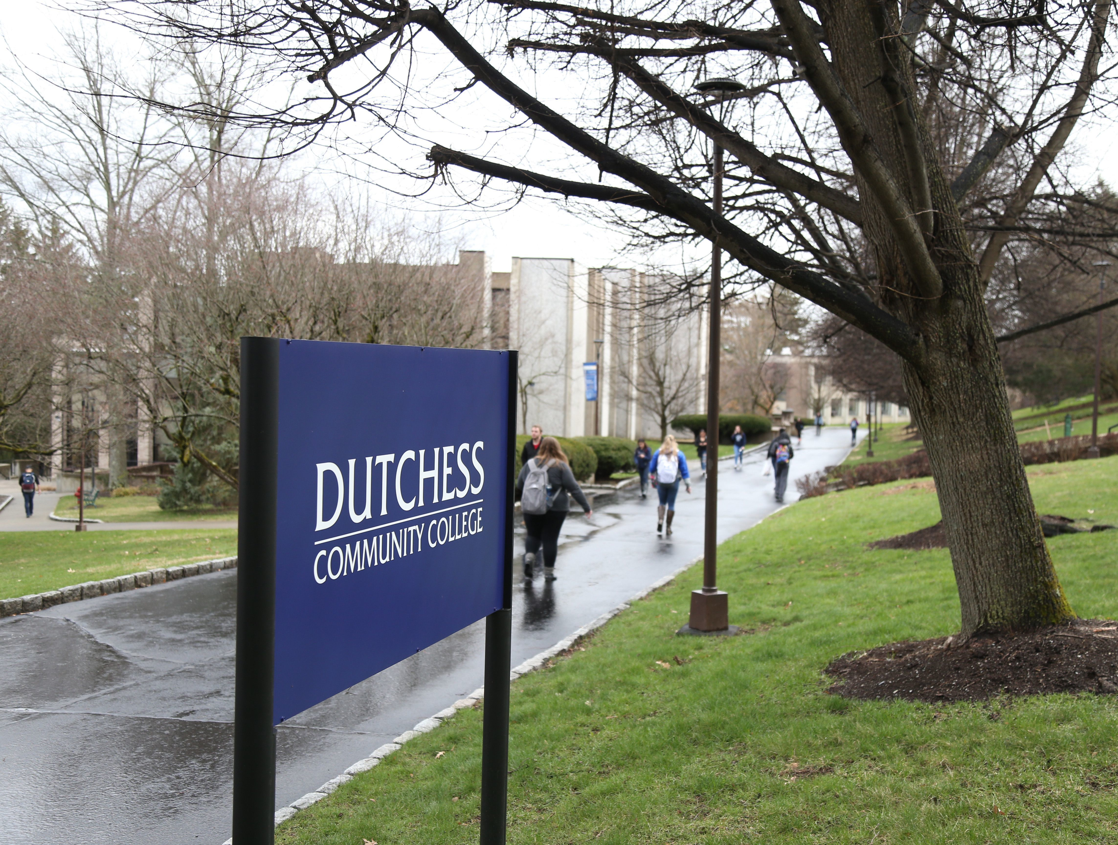 "Students walk to and from buildings at Dutchess Community College. You don't have to feel like you are missing out on the ""college experience"" by not moving away from home."