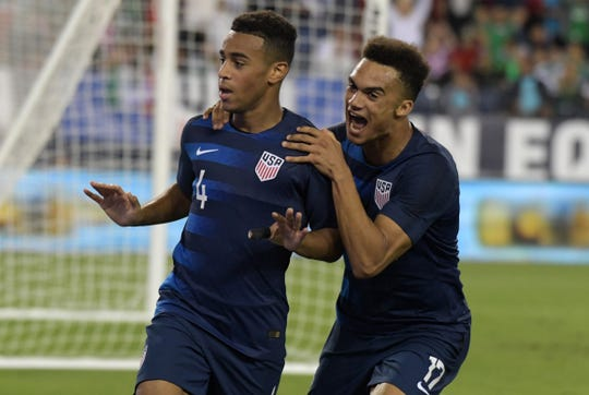United States midfielder Tyler Adams celebrates with defender Antonee Robinson after scoring a goal against Mexico in the second half during an international friendly soccer match at Nissan Stadium in Nashville on Tuesday.