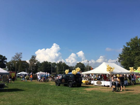 Crowds fill the Ulster County Fairgrounds during the 27th annual Taste of New Paltz festival.