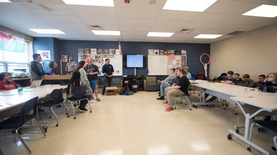 Students meet in a classroom to discuss plans for the new Video Game Club at Career Magnet School on Wednesday, September 12, 2018.