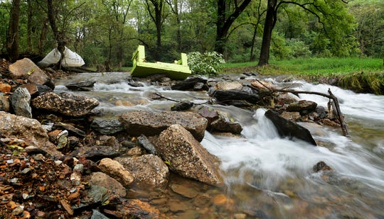 Debris is strewn along Trout Run adjacent to Walker Road in Shrewsbury Township Wednesday, Sept. 12, 2018. The road, which travels under the York County Heritage Rail Trail overpass, has been closed after it was discovered that the depth of had increased after late August flooding. The depth could undermine the foundation for the road and bridge. Bill Kalina photo