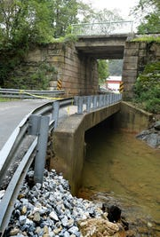 Walker Road in Shrewsbury Township, which travels under the York County Heritage Rail Trail overpass, has been closed after it was discovered that the depth of Trout Run had increased after late August flooding. The depth could undermine the foundation for the entire road-bridge-underpass, Wednesday, Sept. 12, 2018. Bill Kalina photo