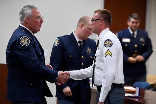 York County Sheriff Richard Keuerleber recognizes Cpl. Taylor Eck with the Distinguished Public Service Award for his actions while rescuing a child locked in a car, during the annual Promotion and Award Ceremony, Wednesday, Sept. 12, 2018.  John A. Pavoncello photo
