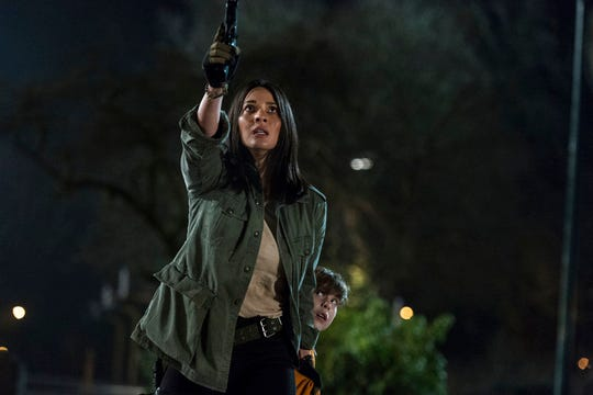 """Olivia Munn, left, and Jacob Tremblay star in  """"The Predator."""" The movie is playing at Regal West Manchester Stadium 13, Frank Theatres Queensgate Stadium 13 and R/C Hanover Movies."""