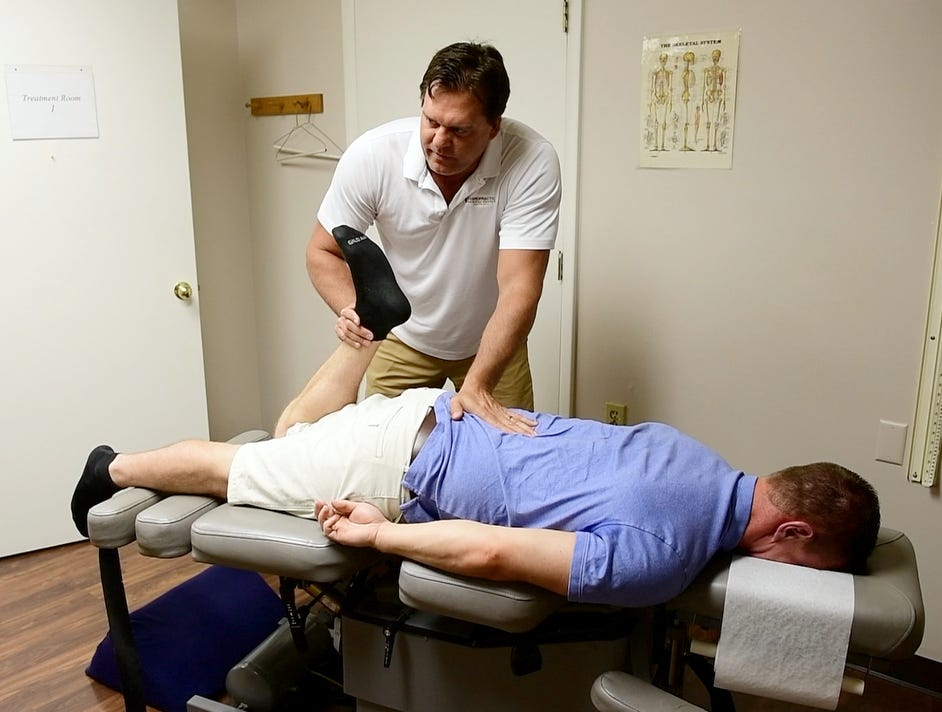 Dr. Kevin Owens, of Chiropractic Athletic Center, works on York Daily Record reporter John Buffone, on Tuesday, August 28, 2018.