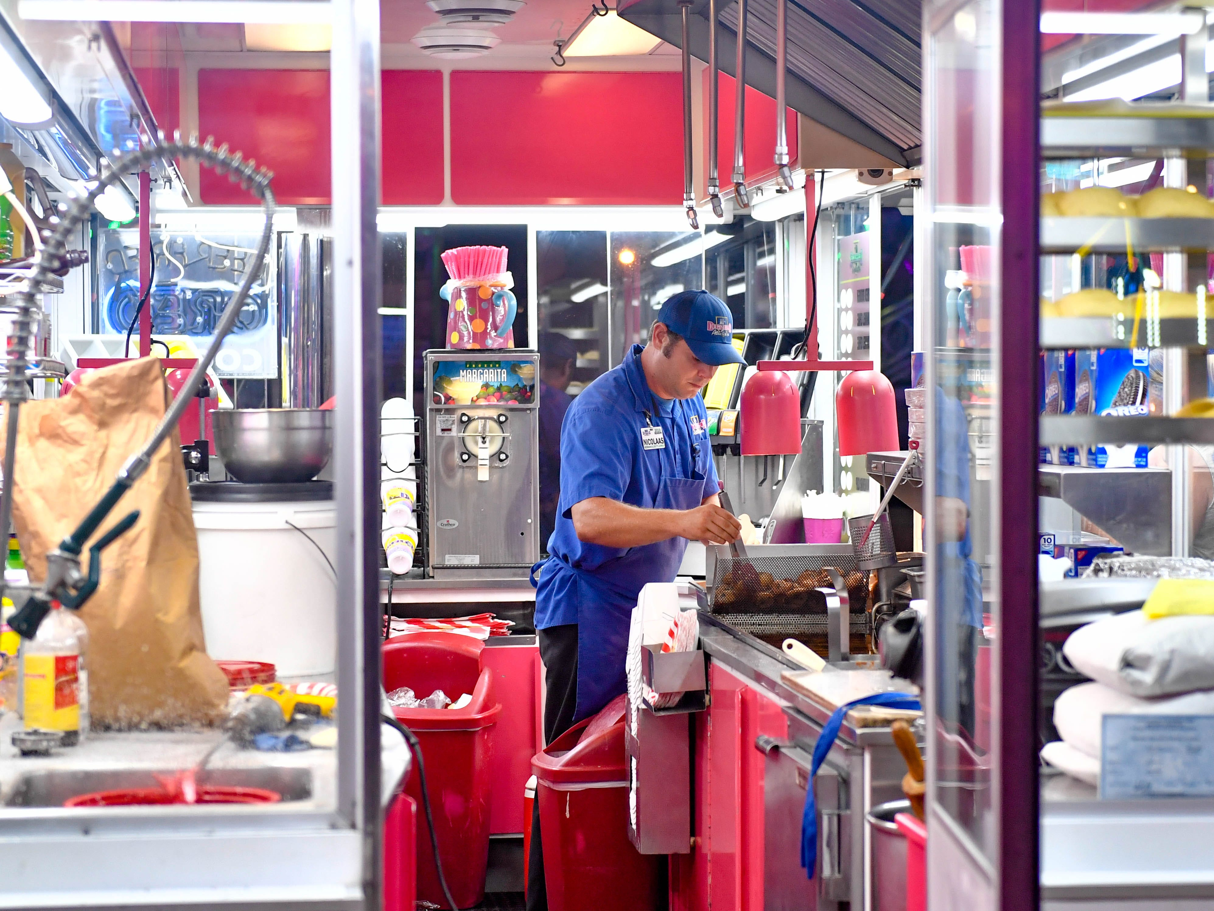 Food vendors continue to prepare food for the masses at the York Fair, Tuesday night, September 11, 2018.
