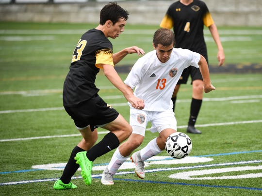 Central York's Zack Mummert (13) keeps control of the ball, September 11, 2018.