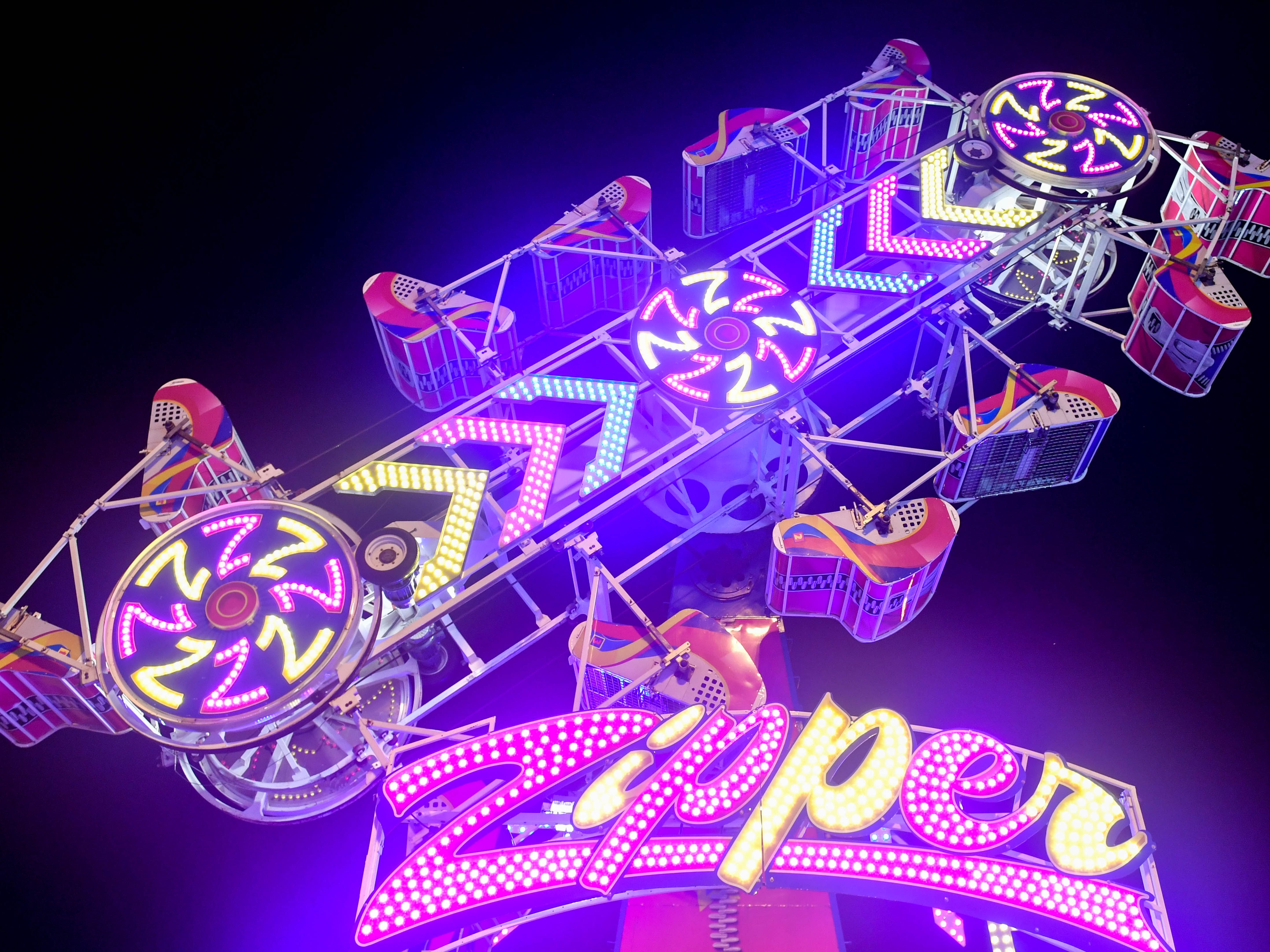 The Zipper is one of the more popular rides at the York Fair. It straps two people into a rolling cage that spins as the ride rotates, September 11, 2018.