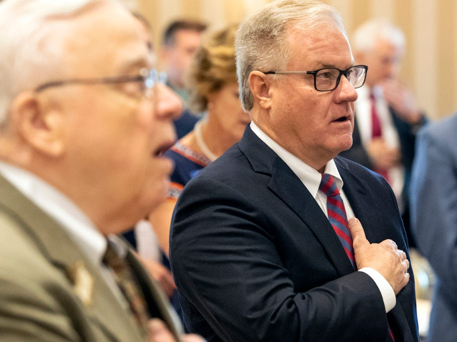 Former state Sen. Scott Wagner says the Pledge of Allegiance prior to speaking to the Rotary Club of York at the Country Club of York on Wednesday, September 12, 2018. The Republican spoke about the opioid epidemic and education, along with his blue-collar roots. Wagner is campaigning against incumbent Gov. Tom Wolf, a Democrat, also of York County.