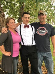 Central York's Hunter Werner poses with his mom, Kori Kelly, and stepfather, Ron Kelly, before Central York's 2017 homecoming dance.