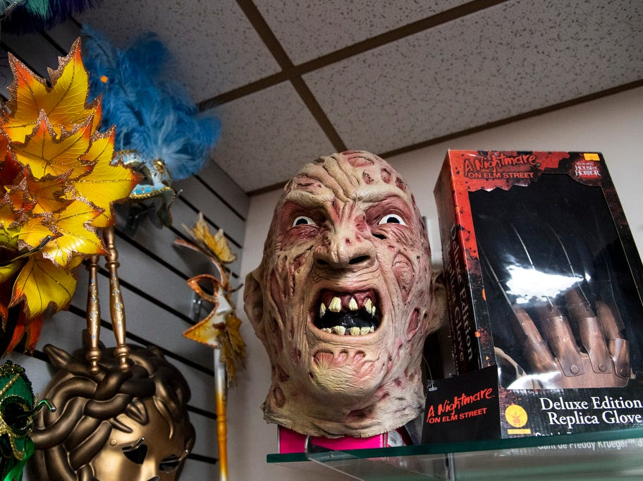 As a locally owned costume store, Debbi Reck says it's not always easy to get trending costumes, due to licensing. But there are some well-known masks around the store, like this Freddy Krueger mask, Wednesday, September 5, 2018. Debbi Reck has owned Make Believin' Costumes, in York Township, for 35 years. She said that over the years, costume designs for Halloween have become more creative.