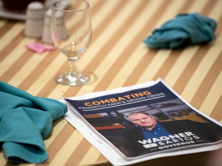 A paper pamphlet sits on the table as former state Sen. Scott Wagner speaks to the Rotary Club of York at the Country Club of York on Wednesday, September 12, 2018. The Republican spoke about the opioid epidemic and education, along with his blue-collar roots. Wagner is campaigning against incumbent Gov. Tom Wolf, a Democrat, also of York County.