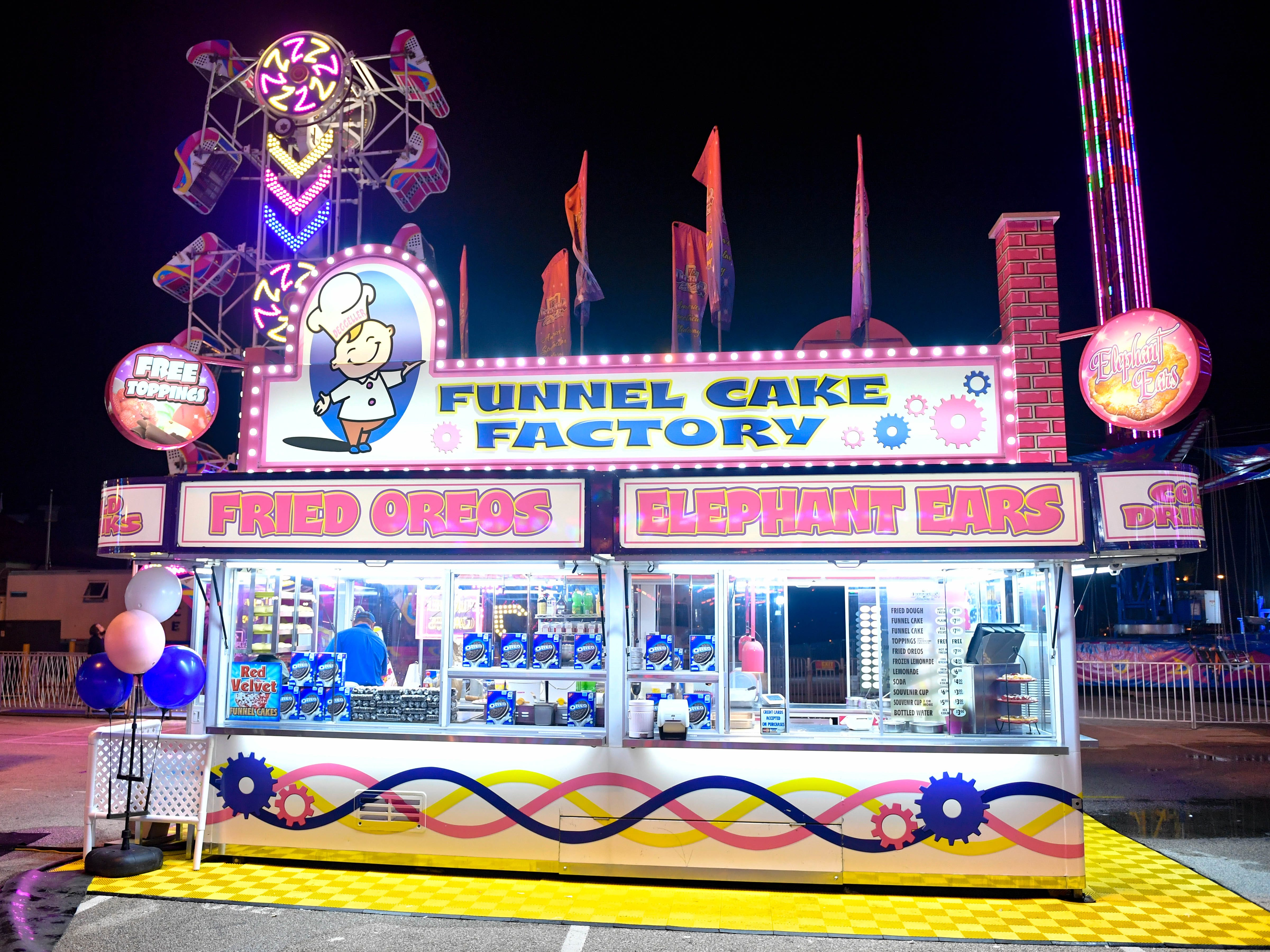 At night everything is lit up at the York Fair including the food vendors, September 11, 2018.