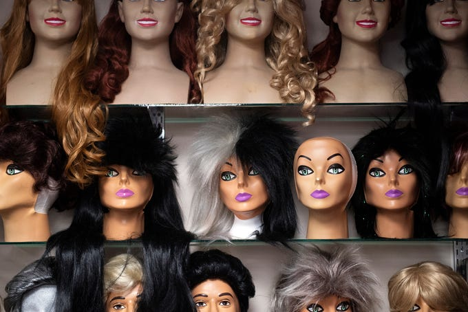 Wigs decorate shelves on walls at Make Believin' Costumes, Wednesday, September 5, 2018. Debbi Reck has owned Make Believin' Costumes, in York Township, for 35 years. She said that over the years, costume designs for Halloween have become more creative.