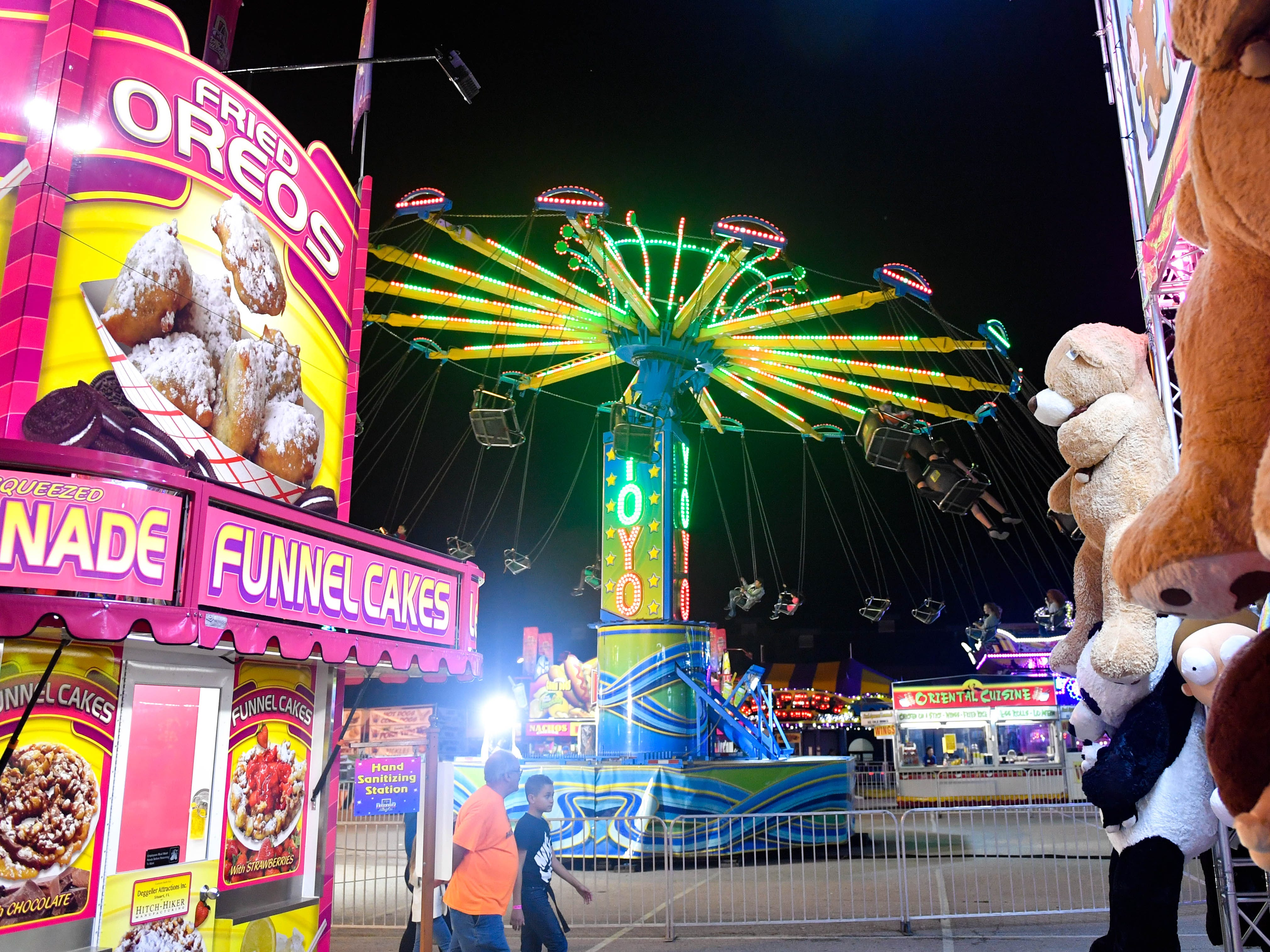 The Yo Yo is a swing ride that spins riders 30 feet off of the ground at the York Fair, September 11, 2018.