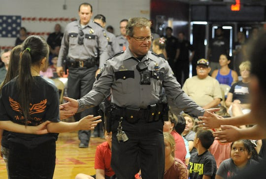 Emergency responders get high-fives from students at Fernley Intermediate School.
