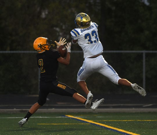 Bishop Manogue's Colby Crisp (2) makes a catch for a touchdown against Reed's Angel Barboza during their football game in Reno on Aug. 24, 2018.