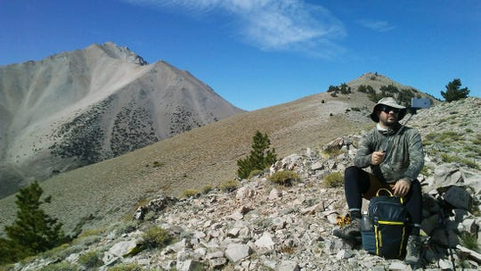 Benjamin Spillman of the Reno Gazette Journal and USA Today Network shooting photo and video on Boundary Peak on Sept. 9, 2018.