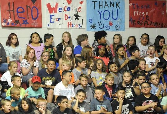 Fernley Intermediate School students listen during their school's 9-11 assembly.