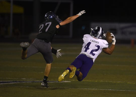 Spanish Springs' Jackson Laduke (42) makes a diving catch while taking on Damonte Ranch during their football game in Reno on Sept. 7, 2018.