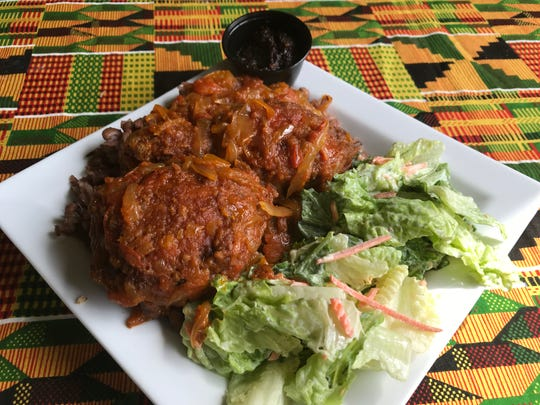 Waakye includes rice and beans, a choice of protein, a tomato stew and a salad.