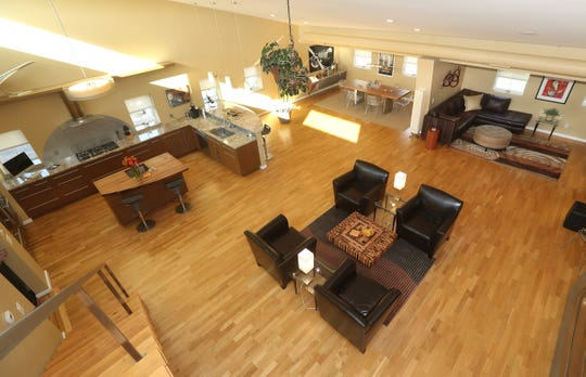 A view of a spacious loft located on Jay Street offer and open and sun filled concept.