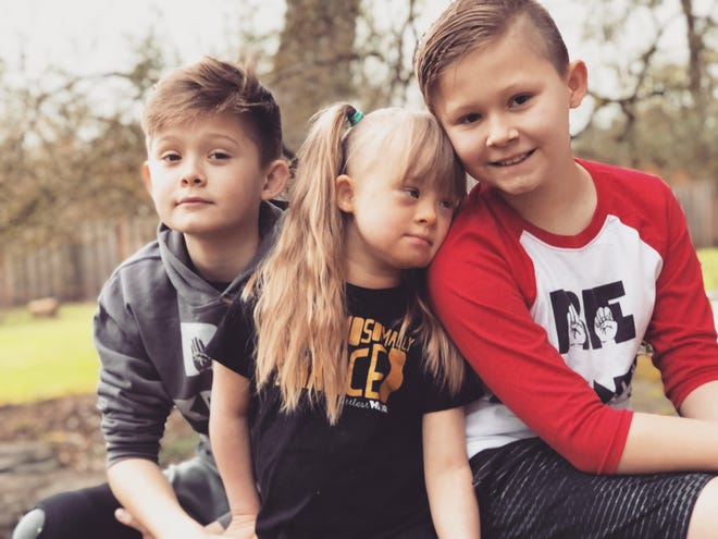 Siblings Will, 11, Ellie, 5, and Lucas Stafford, 9, of Aurora, will be featured in the National Down Syndrome Society's annual Times Square Video presentation on Saturday, Sept. 15.