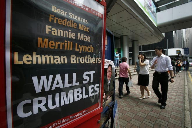 A newspaper headline after U.S. investment bank Lehman Brothers filed for bankruptcy is seen in a Hong Kong street Sept. 16, 2008.
