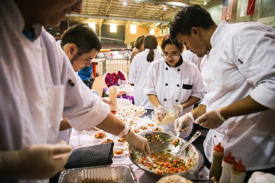 Culinary students from Lake View High School prepare samples during Taste of San Angelo Tuesday, Sept. 11, 2018, at 1st Community Federal Credit Union Spur Arena.