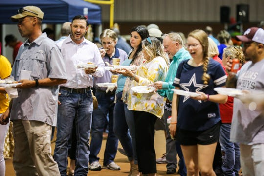 Patrons wait in line for samples during Taste of San Angelo Tuesday, Sept. 11, 2018, at 1st Community Federal Credit Union Spur Arena.