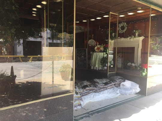Cape Charles Coffee House in Cape Charles, Virginia is closed and has sandbags protecting the entrance on Tuesday, Sept. 11, 2018, in preparation for the arrival of Hurricane Florence.
