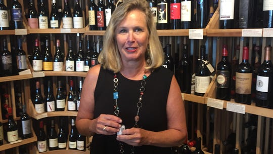 Jenny Corcoran of Cape Charles, Virginia explains how to use the product she invented to help prevent headaches after drinking wine. The product, called Drop It, has been popular after she started marketing it not long ago.