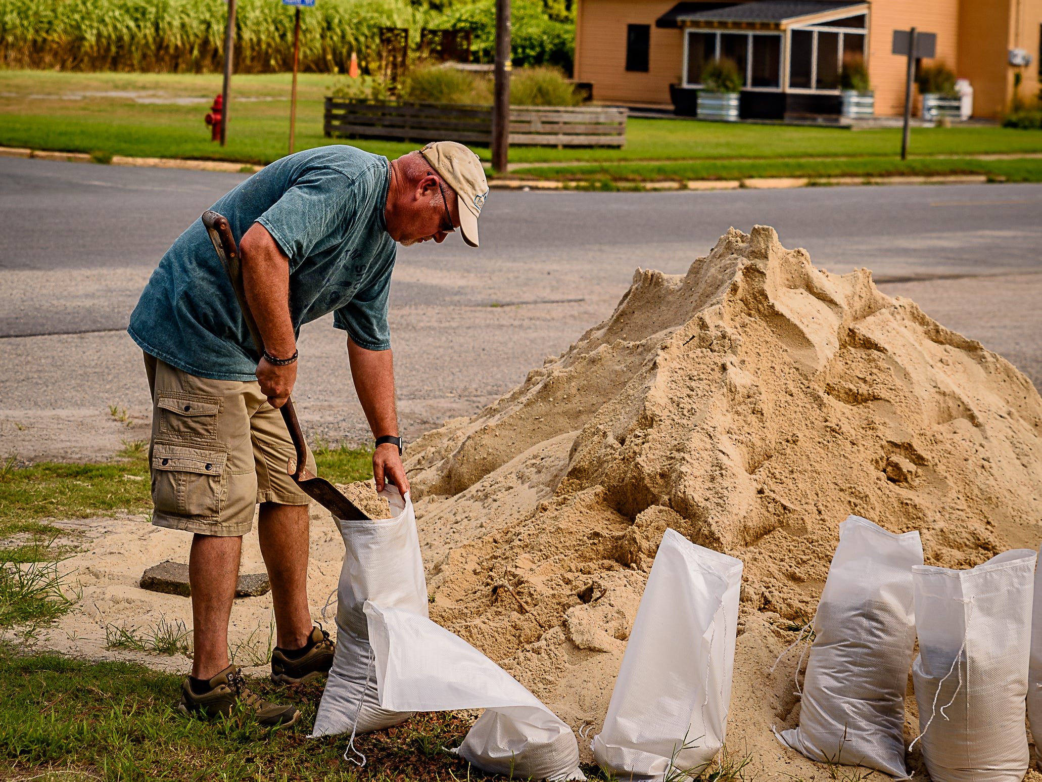 A resident fills bags with sand provided by Cape Charles as Northampton County prepared for the approaching Hurricane Florence.