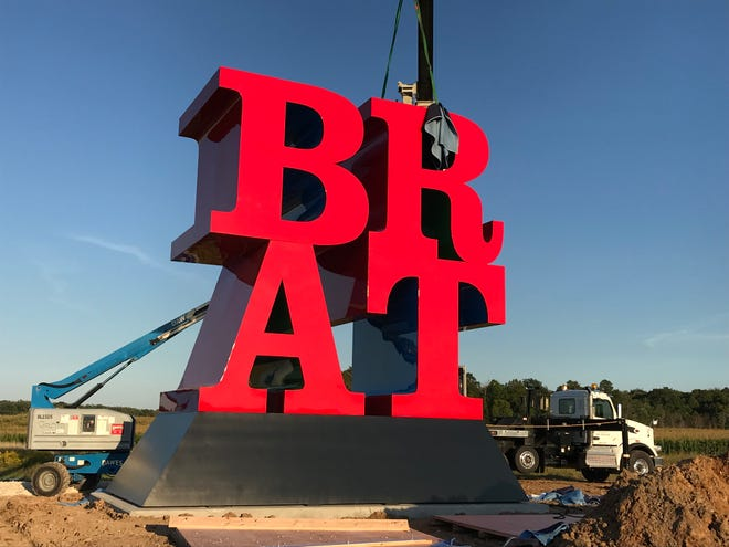 KC Fabrications works on installing Robert Indiana's BRAT at Johnsonville Foods' corporate headquarters, Tuesday, September 11, 2018 in Sheboygan Falls, Wis.