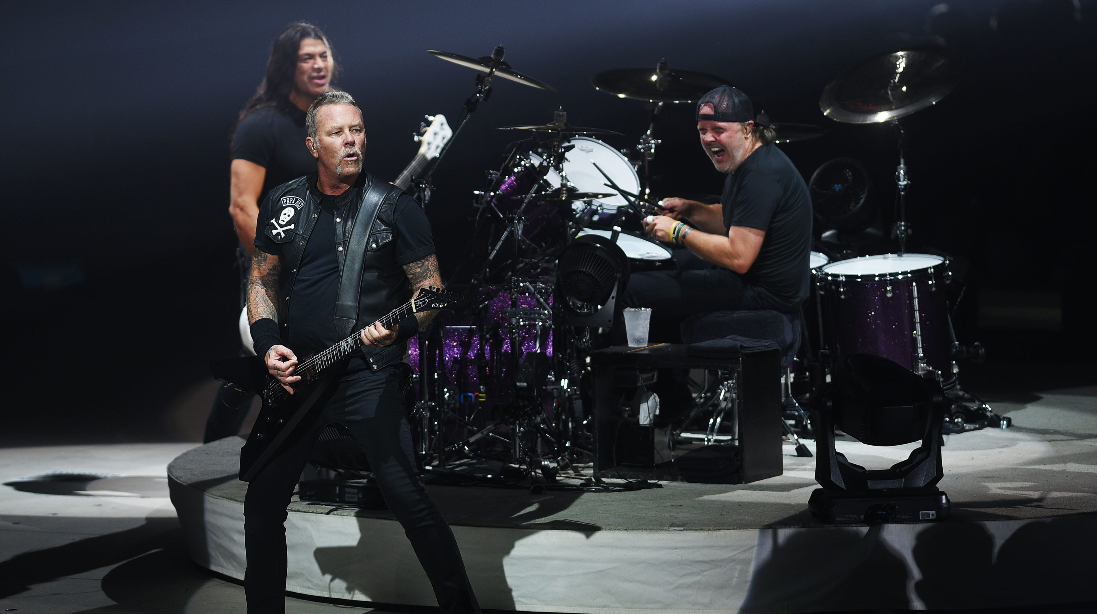 Metallica's James Hetfield, front, Robert Trujillo, back left, and Lars Ulrich, back right, perform Tuesday, Sept. 11, at the Denny Sanford Premier Center in Sioux Falls.