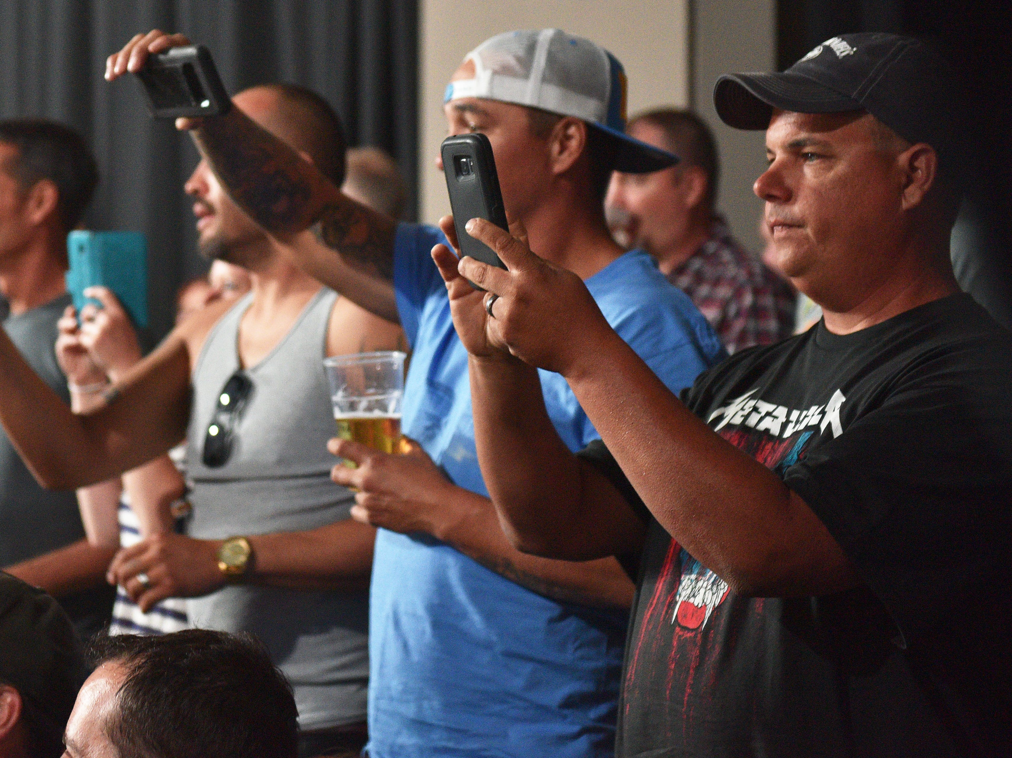 Metallica fans prepare to take photos of the band's entrance for the show Tuesday, Sept. 11, at the Denny Sanford Premier Center in Sioux Falls.