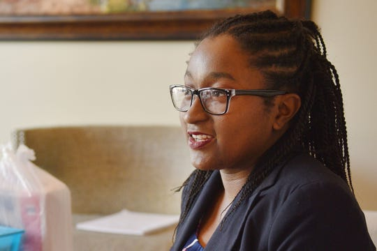 Tatiana Chance talks about a non-profit she is starting Tuesday, Sept.11, at her mother's business in Sioux Falls. Chance hopes the non-profit will help financially unstable women have access to feminine products.