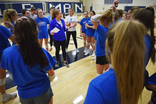 O'Gorman volleyball coach Emily McCourt works with the team Tuesday, Sept. 11, after school at the high school gym in Sioux Falls.