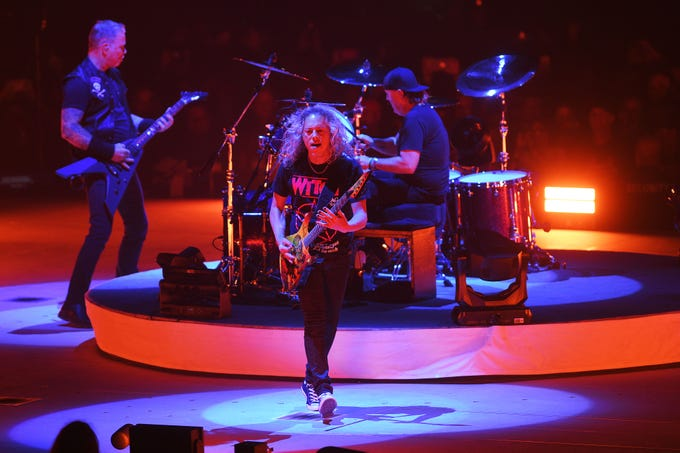 Metallica's Kirk Hammett, center, performs with the band Tuesday, Sept. 11, at the Denny Sanford Premier Center in Sioux Falls.