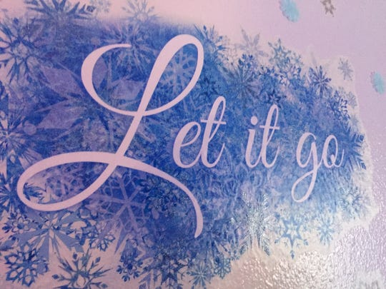 "No ""Frozen"" themed room would be complete without the favorite song title, ""Let It Go."""