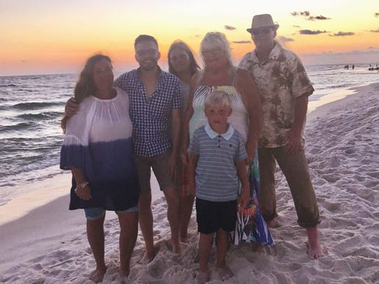 Joshua Brooks (right) and family members during a recent vacation.