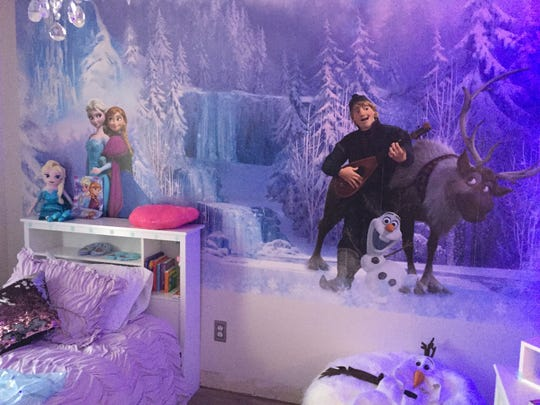 "One whole wall in Evalee's bedroom is covered by a mural from the movie ""Frozen."""