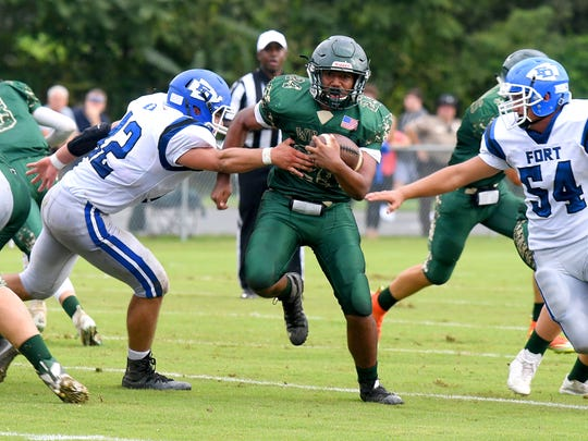 Wilson Memorial's Maurice Johnson finds a hole during the Green Hornets' game with Fort Defiance on Sept. 12.