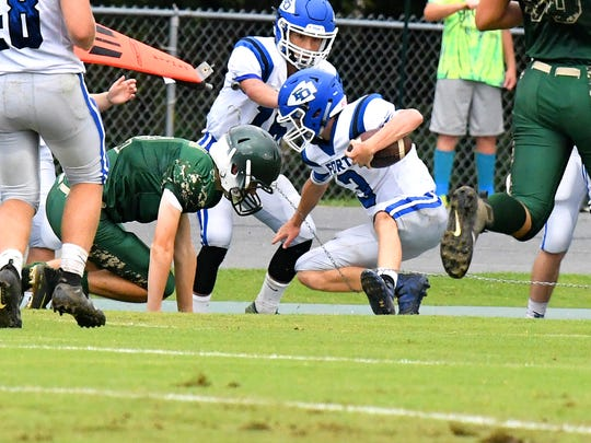 Fort Defiance's Cole Sligh finally goes down along the sidelines after running the ball several yards for a first down during a game played in Fishersville on Wednesday, Sept. 12, 2018.
