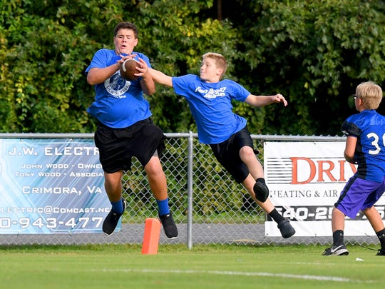An impromptu round of football play takes place on the field about 30 minutes before kickoff of a game played in Fishersville on Wednesday, Sept. 12, 2018.
