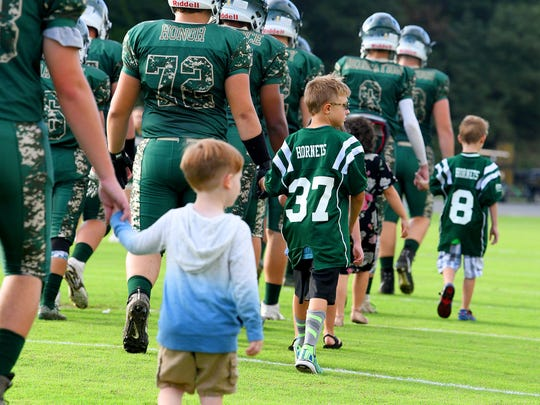Pediatric cancer survivors join Wilson Memorial players in taking the field for a game played in Fishersville on Wednesday, Sept. 12, 2018.