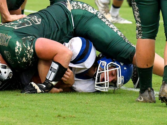 Fort Defiance's Trevor Bartley is bottom of the pile as he is tackled with the ball during a game played in Fishersville on Wednesday, Sept. 12, 2018.