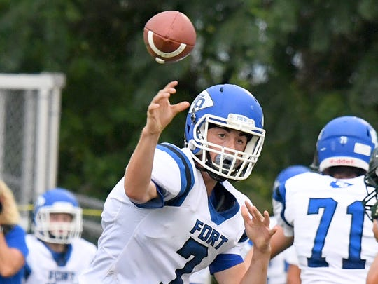 Fort Defiance quarterback Austin Monroe passes the ball during a game played in Fishersville on Wednesday, Sept. 12, 2018.